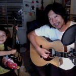 me-and-julian-playing-guitar
